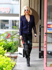 Gwen Stefani styled her cardigan with cute plaid-patched pants.