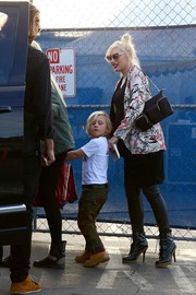 Gwen Stefani contrasted her girly blazer with a pair of edgy black lace-up boots.