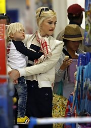 Gwen Stefani wore a red plaid scarf while out with her family on errands.