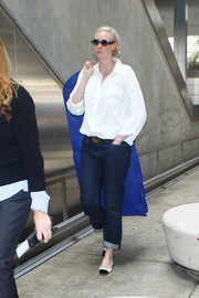 Gwendoline Christie sealed off her airport look with flat black-and-white Mary Janes.