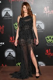 Gemma Arterton vamped it up in this sheer polka-dot gown with a thigh-high slit.
