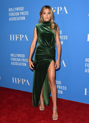 Sistine Stallone was sultry and sophisticated in a green velvet gown with a thigh-high slit at the 2019 HFPA Grants Banquet.
