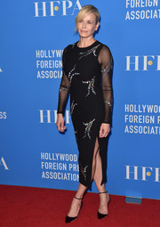 Chelsea Handler was sultry and chic in an embroidered black Cinq à Sept dress with sheer sleeves and a high side slit at the HFPA Grants Banquet.