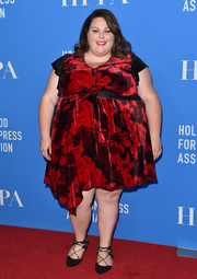 Chrissy Metz opted for a red RACHEL Rachel Roy floral dress with an asymmetrical hem when she attended the HFPA Grants Banquet.