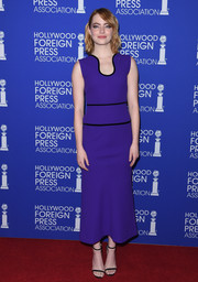 Emma Stone made an appearance at the HFPA Grants Banquet wearing a purple Roland Mouret frock with a curvy neckline and black piping.