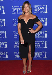 Gina Rodriguez put on a busty display at the HFPA Grants Banquet in a BCBG Max Azria off-the-shoulder LBD with a plunging, angular neckline.