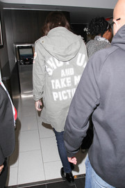 Hailee Steinfeld was spotted at LAX sporting a 'Shut up and take my picture' parka.