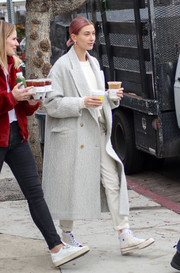 Hailey Bieber kept her feet comfy in a pair of high-top canvas sneakers by Converse x FOG Essentials.