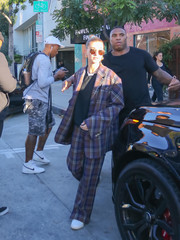 Hailey Baldwin was impossible to miss in this oversized plaid pantsuit by Irene while out in LA.