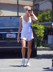 Hailey Bieber stepped out on a hot day in LA wearing a ruched white mini dress by Alexander Wang.