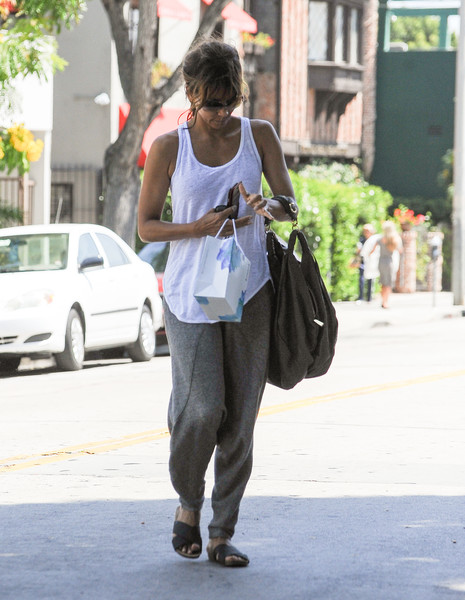 Halle Berry continued the relaxed vibe with a pair of cross-strap slides.