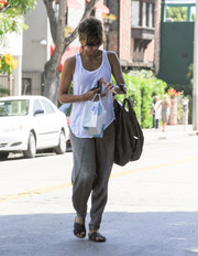 Halle Berry topped off her cool ensemble with a white tank top.
