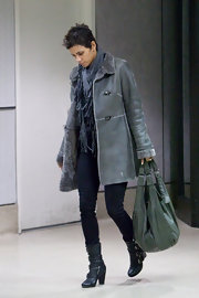 Halle Berry carried an oversized olive green leather hobo bag at LAX.