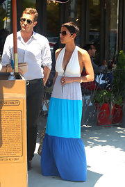 Halle Berry stepped out for dinner in her colorful striped maxi-dress with Olivier Martinez by her side.