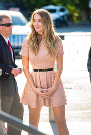 Hannah Davis wears a soft pink above-the-knee lace mini dress while appearing on 'Extra'.