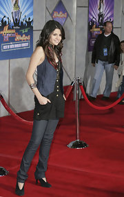 Selena wore her cuff bracelet up high on her forearm, creating a trendy look with her denim vest.