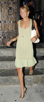 Looking a little on the skinny side, Nicole Richie heads to friend Brandon Davis' birthday bash wearing a simple mint green frock and white and black leather bag.