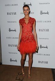 Jacquetta Wheeler looked so stunning in this red feathered lace number at the Harper's Bazaar Women of the Year Awards.
