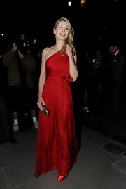 Rosamund looked extraordinary in this silky scarlet red gown at the Harper's Bazaar Women of the Year Awards.