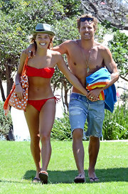 Ashley Hart flaunted her bod wearing a red bandeau bikini while out with Buck Palmer at Bondi Beach.