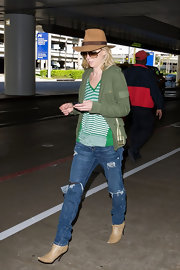 Anne Heche looked casual chic in tan ankle boots paired with distressed denim. A camel fedora and oversize shades complete the incognito look.