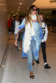 Heidi Klum was seen at LAX wearing a blue mixed-print tunic.