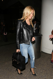 Heidi Klum was rocker-chic at LAX in a black Versace leather jacket with quilted shoulders.