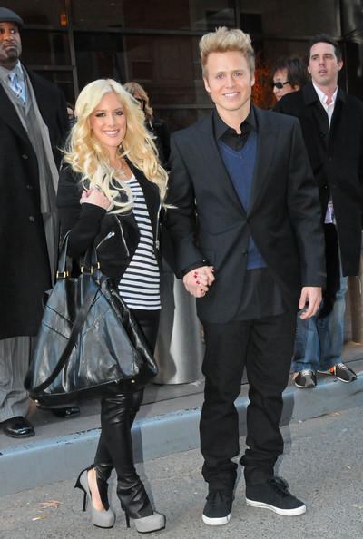 """Heidi sported the ever popular """"Tribute Too"""" platform pumps in grey with her side-zip pleather pants."""
