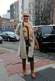 Katherine Heigl had an equestrian vibe in NYC wearing a leather-trimmed coat and riding boots.