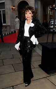 Joan Collins simply sparkled in a black sequin pantsuit.