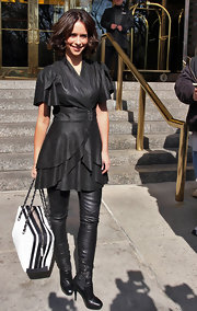 Jennifer completed her all leather ensemble with a pair of black high heeled ankle boots.