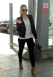 Former teen queen Hilary Duff showed her edge with a classic leather jacket.