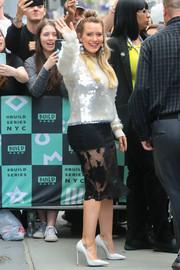 Hilary Duff looked radiant in a paillette sweater by Marc Jacobs while attending a Build series event.