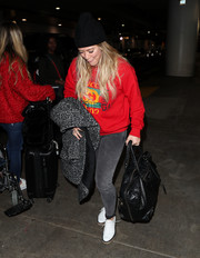 Hilary Duff teamed her top with gray skinny jeans.