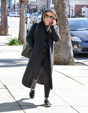 Hilary Duff stayed low-key in a black wool coat layered over a hoodie while strolling in LA.