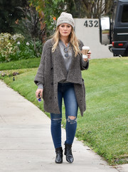 Hilary Duff stayed cozy in a gray shawl-collar cardigan while strolling in LA.