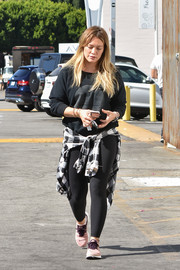 Hilary Duff kept it toned down in a black sweatshirt and matching leggings while out in LA.