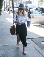Hilary Duff completed her look with a pair of studded slide sandals.