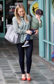 Hilary Duff looked conservative in a long-sleeve print blouse as she took her son to baby gym class.