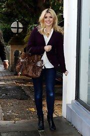 Holly Willoughby opted for this plum cardigan for her fall time look while out in London.