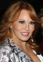 Raquel Welch matched her look with a pair of intricately designed earrings at the 'Hollywoodland' premiere.