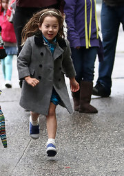 Ava Jackman's spiffy gray pea coat was a classic way to frolic in the rain.