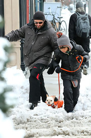 Oscar Jackman kept himself warm in a jet black puffa jacket as he and his dad took their dog for a walk.