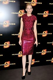 Elizabeth Banks pulled out all the stops for the French premiere of 'The Hunger Games' wearing a show-stopping sequined dress and mile-high black heels.