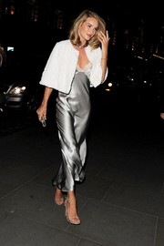 Rosie Huntington-Whiteley added a little warmth to her slinky dress with a white fur cape.
