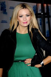 Nicola McLean painted her nails with dark red polish for the premiere of 'Ice Age.'