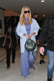 Iggy Azalea was spotted at LAX wearing blue wide-leg pants and a matching top.