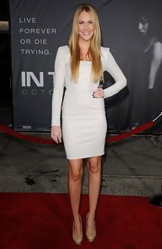 Sarah Carroll topped off her fitted white dress with nude platform pumps.
