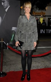 Jenna Elfman took to the red carpet at the 'In Time' premiere in patent leather black ankle boots.