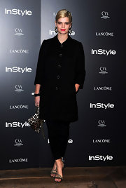 Pixie rocked the 'InStyle' soiree in a black ensemble and embellished strappy sandals.
